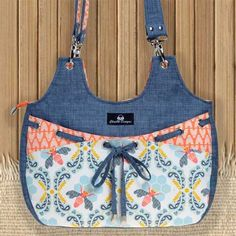 This bag has a stylish design with a decorative threaded bow on the front
