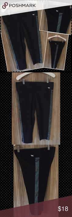 """VS PINK YOGA Crop pants MEDIUM VS Victoria's Secret PINK YOGA pants Color: black with net side and features the PINK pup in white side front waist 16"""" waist across 20"""" length. Sz Medium  Pre owned in good condition no holes or stains.. but does show fade from washing. Smoke/pet free. ❤️gladly Bundle. No trades. No holds PINK Victoria's Secret Pants Track Pants & Joggers"""
