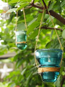 Repurposed Vintage Glass Insulators for Outdoor Candles - Mark Kintzel.Wordpress.com