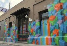 Nerf has painted the front of a creative agency in Palermo with a brilliant new design. It features two waterfalls of cascading colours surrounded by a landscape of Nerf's 3-D shapes.