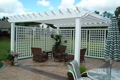 """This approximately 16' x 14' pergola is free-standing, The 5"""" posts are mounted on the concrete. It features built-in decorative corners. ..."""