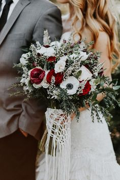 large white + red + green bridal bouquet with macrame wrap (from etsy)