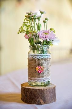Burlap Wrapped Jars with Cute Buttons - 17 Homemade Wedding Decorations for Couples on a Budget - EverAfterGuide
