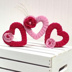 Add some festive Valentine's decor to your home or classroom with these felt wrapped styrofoam h...