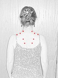 Trapezius Trigger Points.  Using a tennis ball to self massage sore areas.