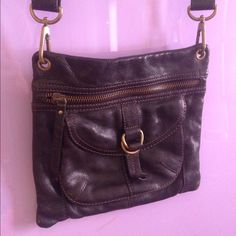 """Leather Crossbody 10"""" wide , adjustable strap , longest being about 26"""" from shoulder, 3 zipper pockets , and a pocket in front with magnetic closer Fossil Bags Crossbody Bags"""