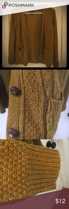 Olive green cardigan A cozy, knit cardigan with brown buttons perfect for sitting by the fireplace and drinking tea. Forever 21 Sweaters Cardigans