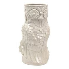"""Ceramic owl vase.      Product: Vase  Construction Material: Ceramic  Color: White  Dimensions: 14.25"""" H x 7.5"""" W x 8"""" D     Cleaning and Care: Wipe with dry cloth"""