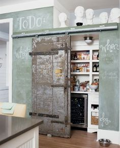 i'd rather have a larger nook for the pantry, and chalk-board sliding doors to cover them, than a huge chalk-board wall with no storage.