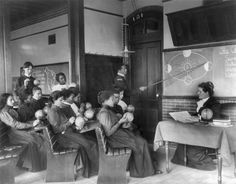 Frances Benjamin Johnston - A class in mathematical geography studying earth's rotation around the sun, Hampton Institute, Hampton, Virginia, 1899