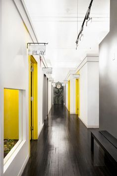 Corridor with yellow doors Medical Office Design, Healthcare Design, Clinic Design, Gym Design, Sala Vintage, Hostels, Hotel Corridor, Student House, Doctor Office