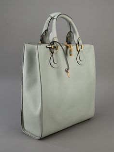 loves this mint -y tote as briefcase for ladies