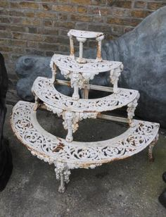 Wrought iron demilune plant stand.