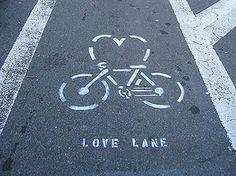 "Bike lane graphic w/heart added to the bike. Labeled ""love lane"" instead of bike lane."