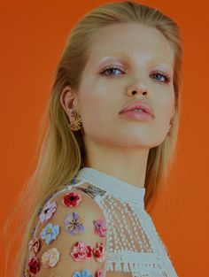 Getting her closeup, Daphne Groeneveld wears floral appliqué top