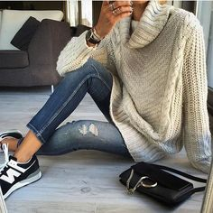 Try a turtleneck sweater, distressed skinny jeans, new balance sneakers, and a chloe faye handbag. Shop the look and more here...