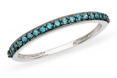 1/4 carat blue diamon in 14k white gold ring with black rhodium. from ice.com