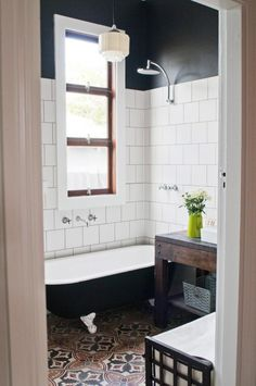 Bathroom with subway tile, black grout, clawfoot tub, patterned encaustic tile floor, via Bad Inspiration, Bathroom Inspiration, Laundry In Bathroom, Small Bathroom, White Bathroom, Bathroom Ideas, Eclectic Bathroom, Bathroom Inspo, Eclectic Tile