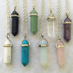 Crystal Pendant Necklaces/ Hexagonal Crystals/ Crystal Point Necklaces  Our most popular gemstone crystals on a necklace or keyring Choose 18 black leather cord, 18 silver chain, or silver ball chain in any length, or a 32mm keyring  Amethyst Rose Quartz Opalite Turquoise Howlite White Howlite Blue Sandstone Clear Quartz Aventurine  Sandstone and opalite are manmade. Opalite is popular for its luminous quality and sandstone sparkles.  You can choose a necklace in different lengths in either…