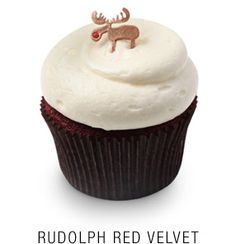 Classic red velvet cupcake with a vanilla cream cheese frosting topped with a fondant red-nosed reindeer (no recipe)