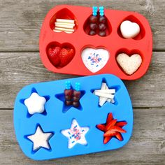 Heart & Star Muffin Tin Meals for kids - Mozzarella string cheese stripes, red grapes on blue heart picks, hard-cooked eggs shaped with heart & star egg molds, little peanut butter sandwiches, strawberries, and yogurt with red & blue cupcake sprinkles.