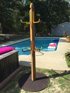 Pool towel rack. Made this with 4x4 post, post cap, ladder hangers and some paint to give it some color. Added the rubber tree ring on the ground so that kids could step out on it to hang there towel. No more 10 loads of dirty towels a week.