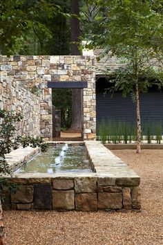 Located in the United States, this beautiful stone residence was designed by Paul Bates Architects. Photography courtesy of Paul Bates Architects Pool Water Features, Water Features In The Garden, Rustic Gardens, Outdoor Gardens, Cottage Gardens, Small Gardens, Modern Fence Design, Garden Fountains, Yard Water Fountains