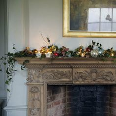Christmas mantelpiece with ivy and candles