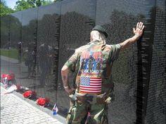 A veteran of World War II, Korea and Vietnam, Elton Ensor, a former U.S. Navy frogman and SEAL, leans against the Vietnam Memorial Wall.