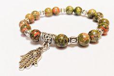 Green Zen semiprecious beaded bracelet, natural Ukanite promoting connectivity, silver Hamsa charm on Etsy, $24.00
