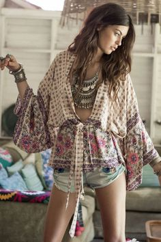 Spell Designs boho chic deep V wrap top with chunky coin embellished gypsy style neccklace for a sexy contemporary modern hippie look. FOLLOW this board now > http://www.pinterest.com/happygolicky/the-best-boho-chic-fashion-bohemian-jewelry-gypsy-/ for the BEST Bohemian fashion trends for 2015.
