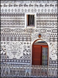 ۞۩   In Greece_On Chios island, architecture admirers can visit the traditional villages, Pyrgi and Olympoi in order to enjoy the characteristic designs of black and white geometrical shapes, reminiscent of the Italian technique of graffiti!