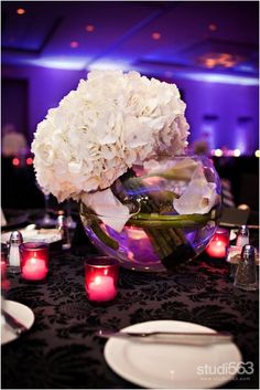 A little modern-swirled callas in the base, slanted bundle of hydrangea coming out of the vase.