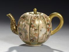 A SATSUMA EARTHENWARE MINIATURE LOBED GLOBULAR TEAPOT AND COVER, MEIJI PERIOD finely painted with