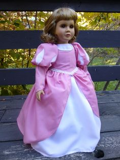 Here's a different take on a pink princess dress, modeled by the same doll.  Instead of satin, this one is broadcloth, both over crepe polyester.