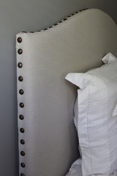 Tips for a do-it-yourself {drop cloth} upholstered headboard with nailhead trim.