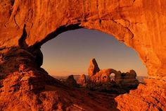 Turret Arch through the North Window at sunrise in Arches National Park