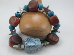 ARE YOU LOOKING FOR A SMART, COUNTRY WESTERN STYLE BRACELET?  THIS IS IT!  CHUNKY TURQUOISE CHALK BEADS AND TURQUOISE GLASS BEADS ARE COMBINED WITH CHUNKY WOODEN BEADS AND ...