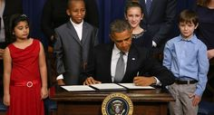 Jan. 16, 2013 Flanked by children, Obama signs an executive order designed to tackle gun control. Obama called on Congress to pass universal background checks and bans on assault weapons and high-capacity magazines, and he announced 23 steps he planned to take without congressional approval (including improving the existing system for background checks and lifting the ban on federal research on gun violence).   (Getty)
