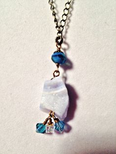 Glacier II necklace. Glistening ripples of icy colored blue Chalcedony accented by Swarovski crystals and Czech glass on antique brass. by GemJelly on Etsy