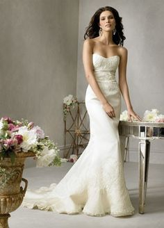 Once Wed has some amazing dresses. They are used but if you are on a budget. I just want to throw this idea out for you.