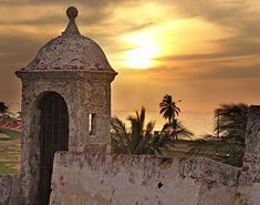 A fortress ruin in Cartagena, Colombia sparks the writer's interest. One generation's prison is another generation's travel attraction! Sunsets and palm trees, a massage for my soul, might not have been so calming to one imprisoned here in times gone by. Quebec, Places To See, Places Ive Been, Trip To Colombia, Colombia Tourism, Spanish Fort, Caribbean Beach Resort, Colombia South America, Latin America