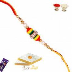 Send White Round Pearl with Colorful Bead Rakhi to India from http://www.rakhistoreonline.com/rakhi/pearl-rakhi/white-round-pearl-with-colorful-bead-rakhi.html