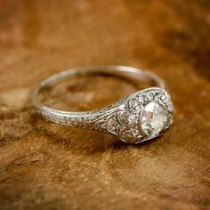 A wonderful antique old mine cut diamond engagement ring. Stunning diamonds, filigree, and milgrain. Circa 1910. #vintageengagementrings #diamondring