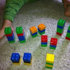 Taking turns making patterns with Legos! I make a pattern...he copies then he makes a pattern... I copy! Preschool fun!