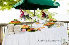 Have a table set up with hors d'oeuvres outside for your guests to enjoy the patio/deck, landscape, and view on your special day! #weddingfood #horsdoeuvres #bayshoregrove #indooroutdoorweddings #indooroutdoorweddingvenues #lakeontarioweddings