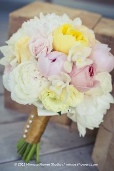 Peonies, roses  orchids. Pretty, soft bouquet. Peonies just speak to me when it comes to weddings.