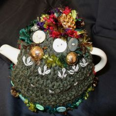 Tea cosies. Keeps your pot warm & adds style to any old tea pot.  This one has vintage buttons, hand made felt & needle felted design on top. Knitted body & fully lined.