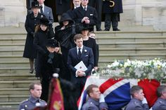 The Funeral Of Sir Angus Ogilvy At St. George's Chapel At Windsor Castle. His Widow, Princess Alexandra, Accompanied By Her Son James Ogilvy And (behind)her Daughter Marina Mowatt And Julia, The Wife Of James, And Their Children Follow The Coffin Which Is Draped With A Union Jack Flag. Grandchildren Zenouska, Christian And Flora Are Also Present.