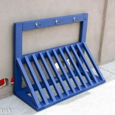 DIY Kid's Bicycle Rack with Helmet Storage Bike rack painted with the HomeRight Finish Max.Bike rack painted with the HomeRight Finish Max. Diy Bike Rack, Bicycle Rack, Pallet Bike Racks, Bike Storage Rack Diy, Bike Storage Hanging, Bicycle Helmet, Bike Storage Stand, Wood Bike Rack, Bmx Bicycle
